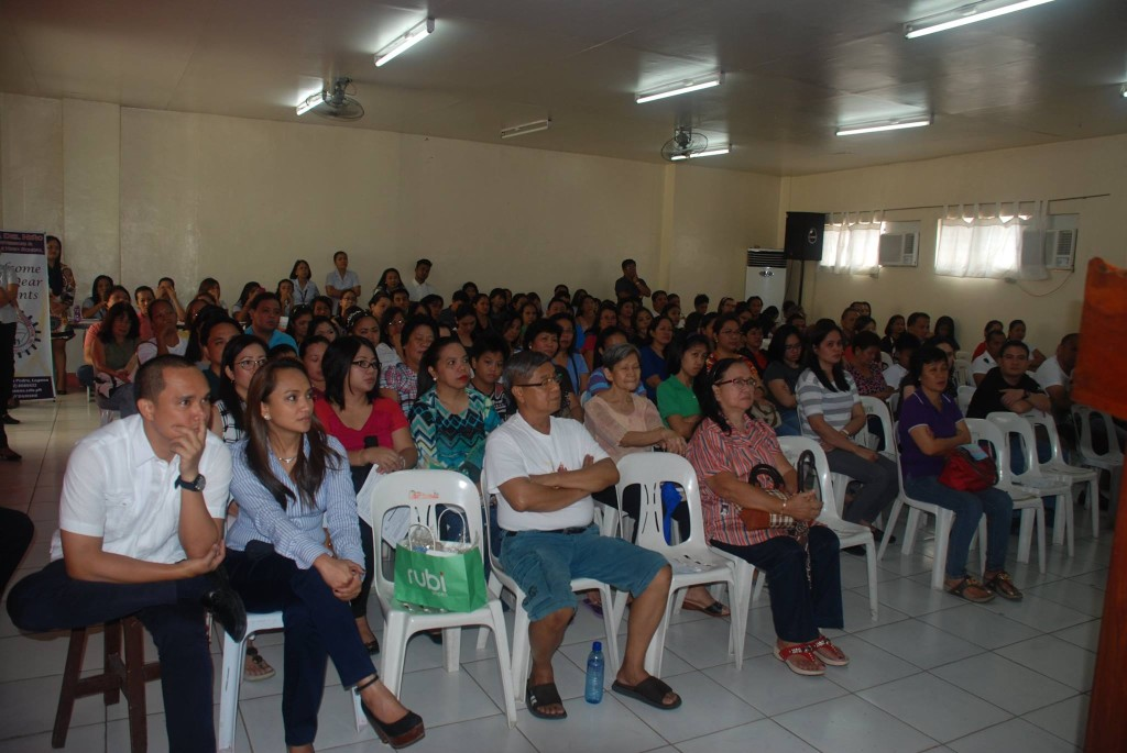 Dr. Mark G. Acierto and Ms. Farah Acierto-Cabanban listen intently with parents during the High School Department's Parents' Orientation.