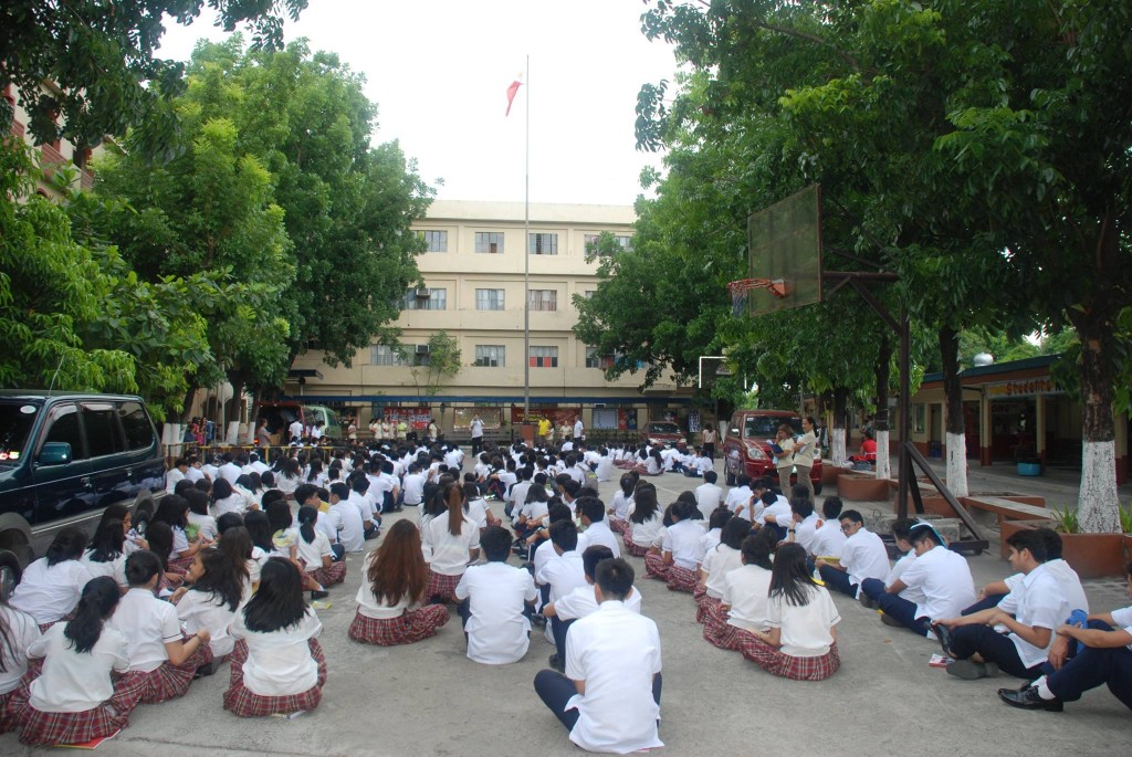 Casans listen to Mr. Ramon Belizario for his assessment after the earthquake drill last Tuesday, 9 June 2015 at the quadrangle of the CDN Pacita 2 Campus.
