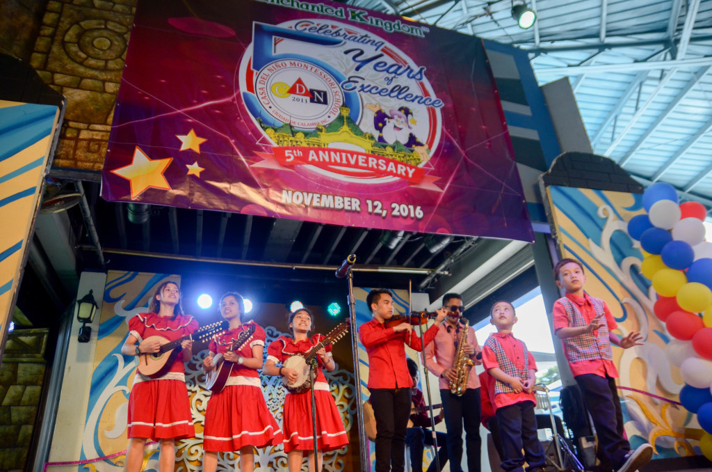 Representatives of Children's Joy Foundation, beneficiaries of the event, perform an instrumental number on stage.