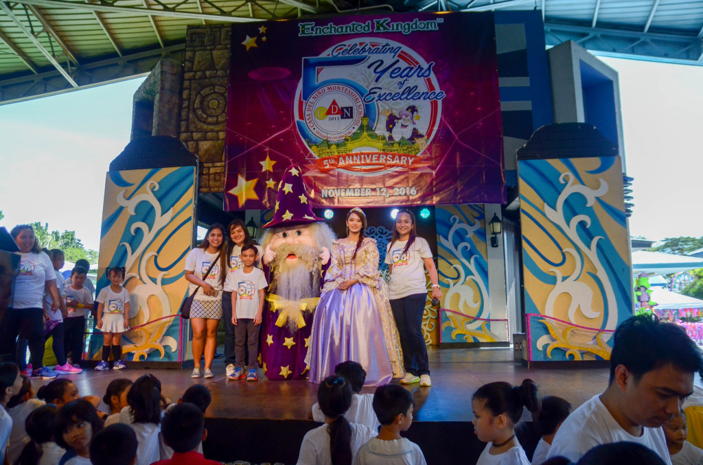 Ms. Farah Acierto-Cabanban(rightmost) and HR Officer Ms. Michelle Asiddao (second from left) pose with EK characters on stage.