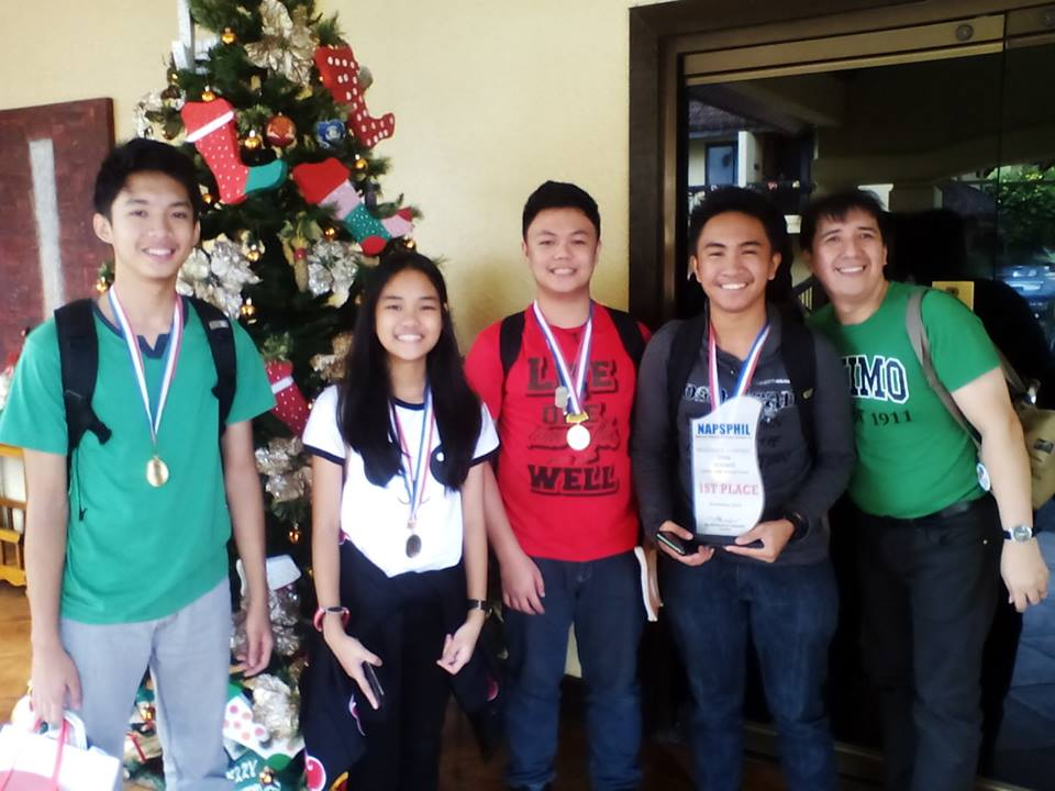 The Science Team members are shown displaying their trophy after the competition at the Lobby of the Hotel Dominique, Tagaytay City last November 22, 2016.  Standing from left to right are Vincent Carl Odiver, Julianne Pineda, Marcus Ariola and Jose Gabriel Escorial together with their mentor, Mr. Herbert San Pedro.