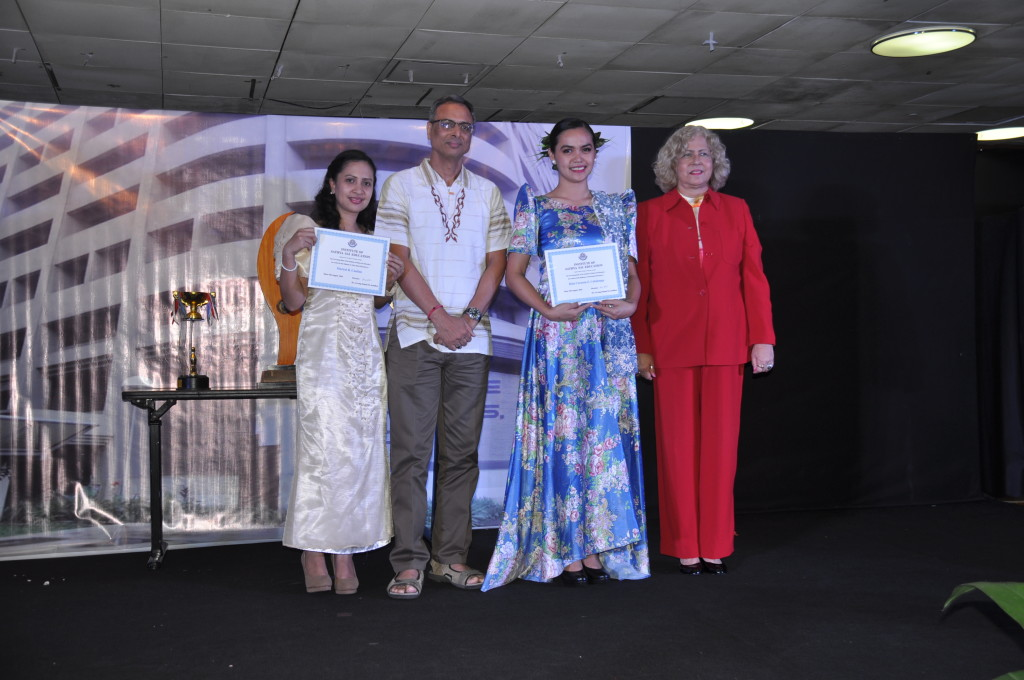 Miss Mace Cauilan (leftmost) and Miss Rola Cabalonga (2nd from right) receive their diplomas from the Indian Ambassador and Venezuelan Ambassadress during the event.