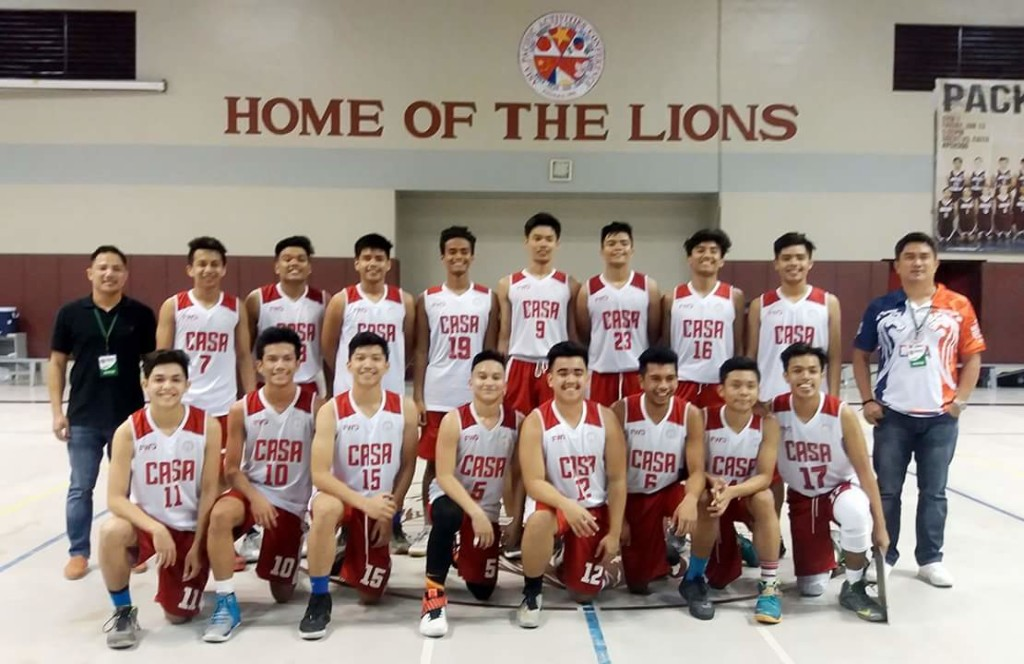 The Red Stallions pose with their coaches Aaron Mendoza (Leftmost) and Dennis Cabanban (Rightmost) at the Brent Int'l School Gymnasium after one of their preliminary games.