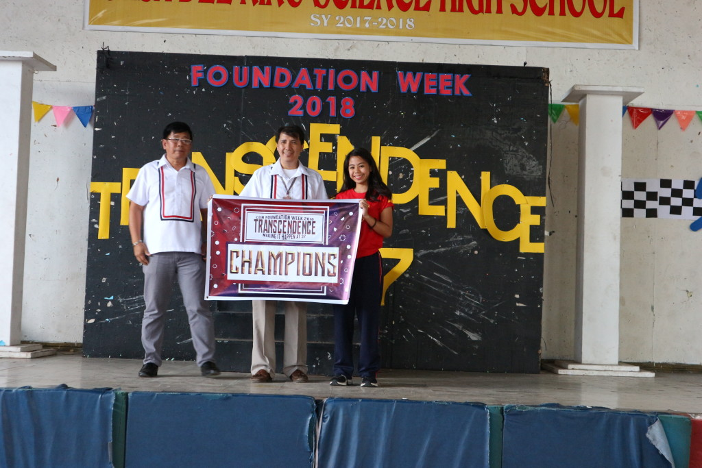 CDNSHS Principal Mr. Richard Pustasa and Senior High School OIC Mr. Herbert San Pedro award the Championship banner to Grade 10 representative Christine Grace Tenio during the Awarding Ceremonies of the 37th Foundation Celebration last Monday, 29 January 2018.