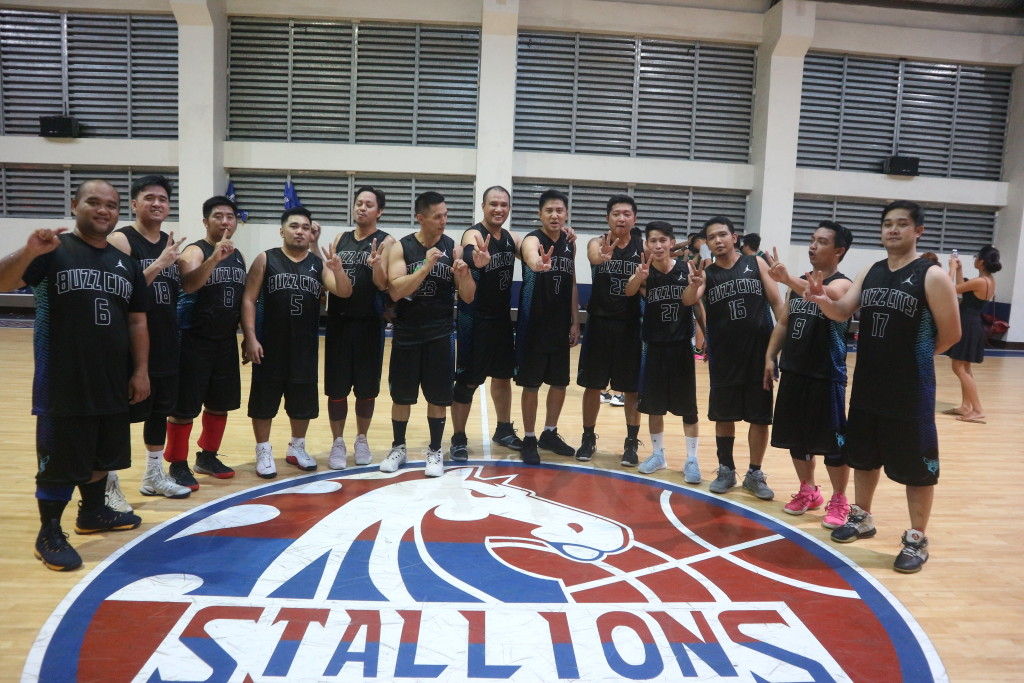 CDN Batch 2002 flash the Victory sign also a sign for their batch after winning the Interbatch Basketball League.