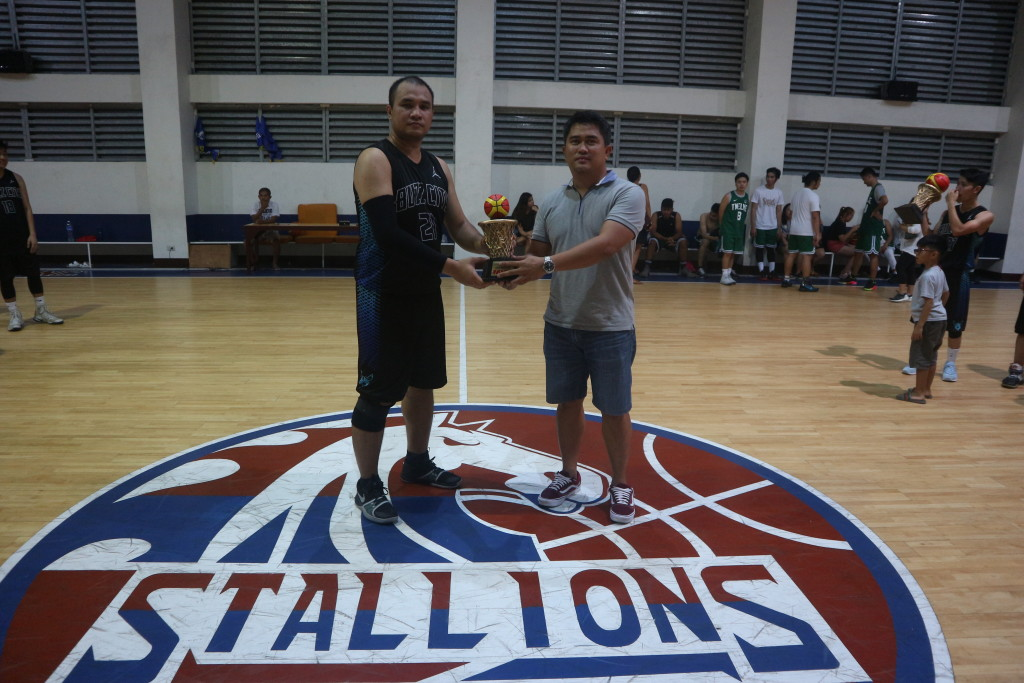 Sports Development Officer, Mr. Dennis Cabanban hands over the MVP trophy to winner, Mr. Leo Neil Viado of Batch 2002