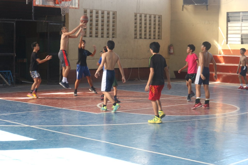 Young basketball enthusiasts go through the drills during the summer-long varsity tryouts at the gymnasium of the High School campus in Pacita 2, San Pedro, Laguna.