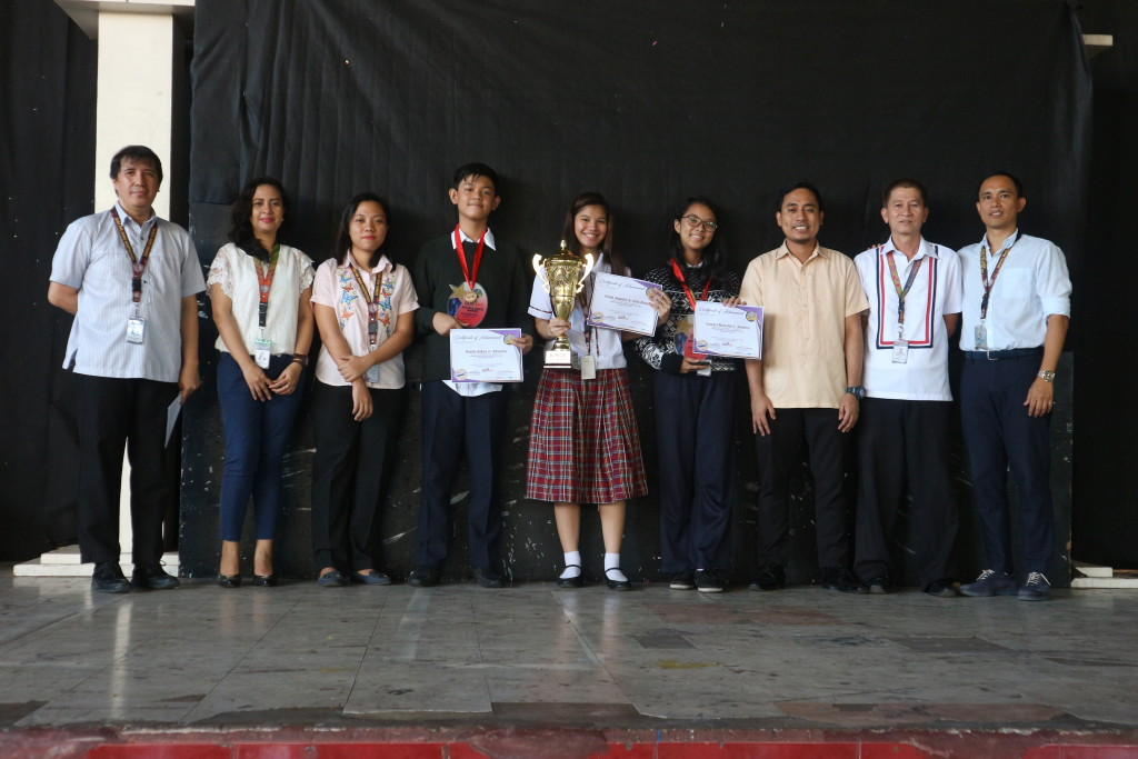 Winners of the National Mathscore Competition Finals pose with their coaches, Math Dept. teachers and school officials during the Flag Ceremony last Monday, November 26,2018.  Standing from left are Mr. Herbert San Pedro (OIC Principal), Ms. Mace Cauilan (Math Teacher), Ms. Jedidiah Saminiano (Math Teacher), Daniel Aiken Eduardo (National Champion, Grade 7), Paolo Angelie dela Rosa (Natonal Finalist),   Jomari Marielle Sandico (National Champion, Grade 8) Mr. Vincent Bryan Reyes (Coach), Mr. Benjamin Aprecio (Coach) and Dr. Mark Acierto (VP for Academics).